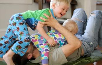 dad-roughhousing-with-toddler